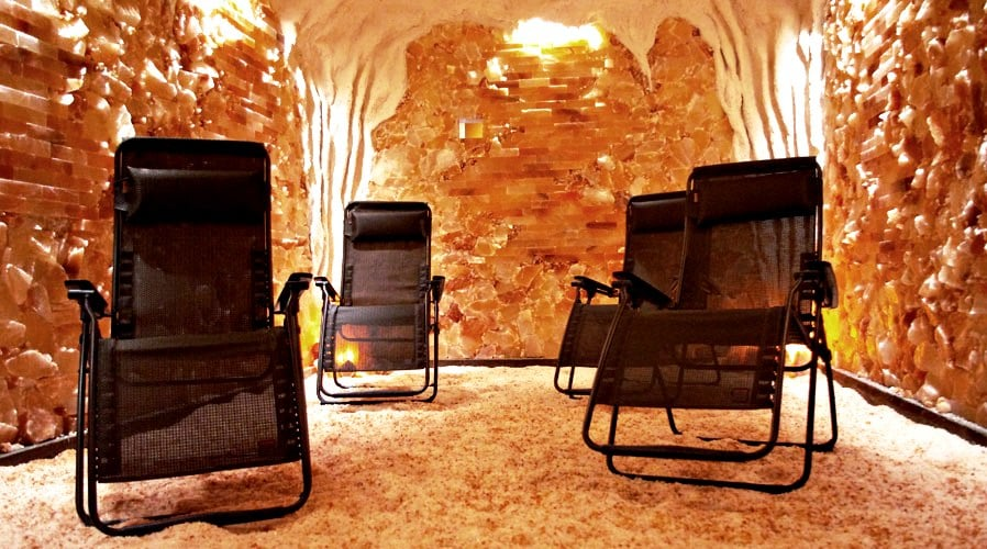 People swear by salt therapy also known as holotherapy. What can a glowing pink room full of salt do for you? Find out in this article.