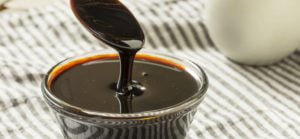blackstrap molasses in a spoon