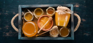 honey in a wooden tray